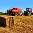 Tractor and Straw - Stock Photo