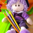 Doll and Pencils - Stock Photo