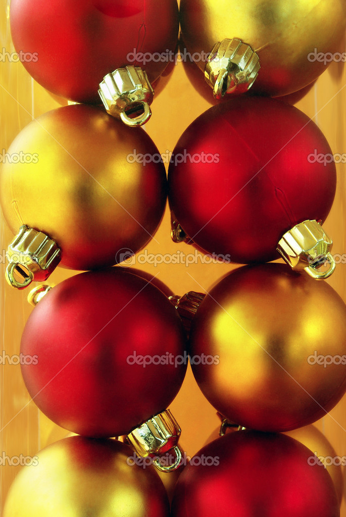 Closeup of a pile of golden and red christmas balls aligned together in a plastic box  Stock Photo #5873978