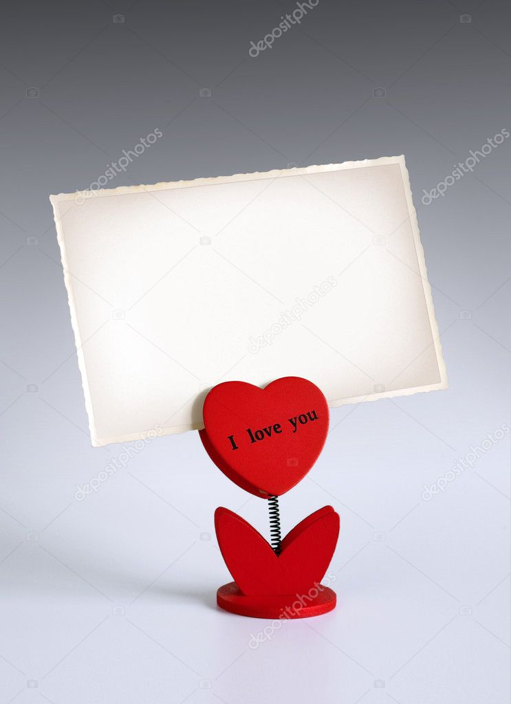Heart-shaped photo holder saying I Love You holding photo  Stock Photo #5874020