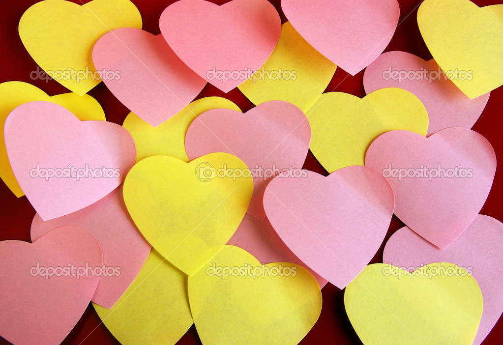 Background of many heart-shaped colorful post its over red — Stock Photo #5874027