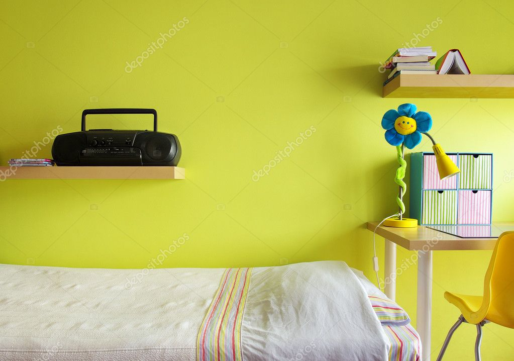 Detail of a teenager bedroom with desk, bed, shelf, and yellow wall  Stock Photo #5874061