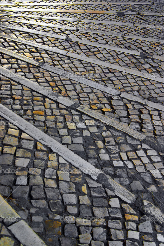 Old typical Portuguese walkway made of cubical stones. — Stock Photo #5874404