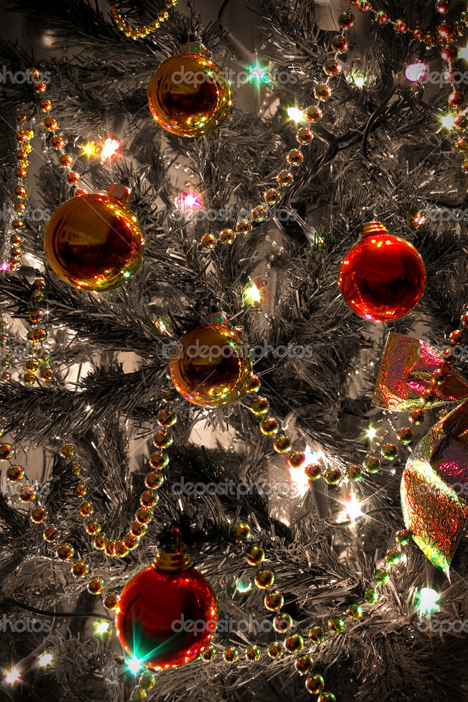 Background of Christmas tree with red and golden balls and shining lights — Stock Photo #5874570