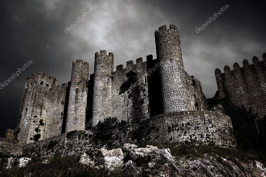 Disturbing scene with medieval castle at night with stormy sky — Stock Photo #5874784