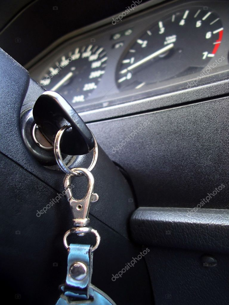 Ignition key inside of a car in a low angle of view.  Stock Photo #5874992