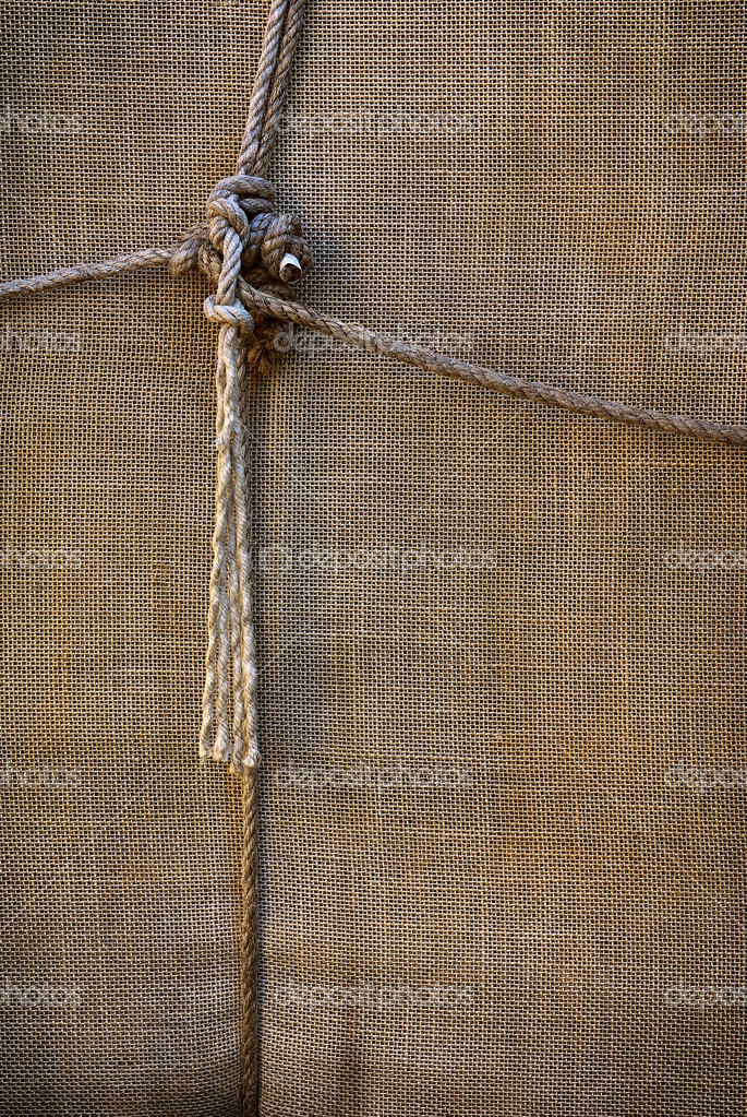 Background of sackcloth wrap tied up with ropes — Stock Photo #5875078