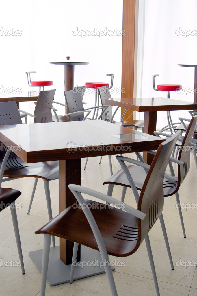 Empty tables in a closed modern coffee shop — Stock Photo #5875099