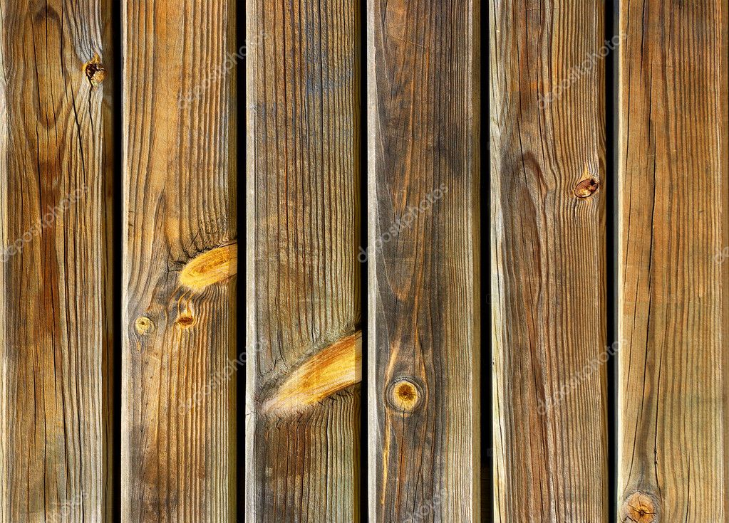 Section of an old fence with wooden planks with knots  Stock Photo #5875217