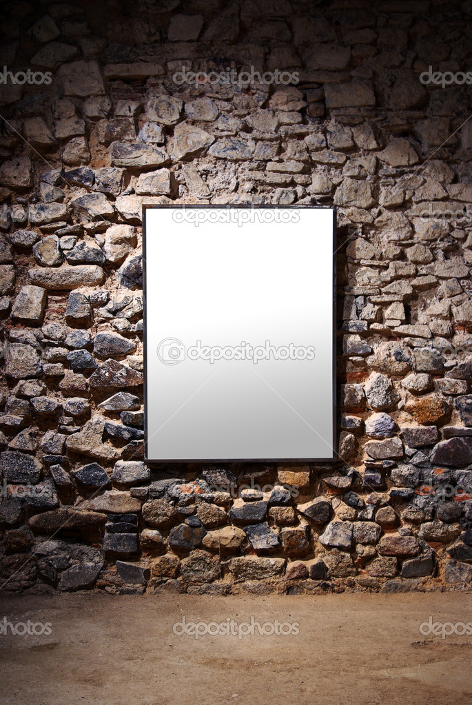 Empty frame attached to a stone wall in a gallery room — Stock Photo #5875255