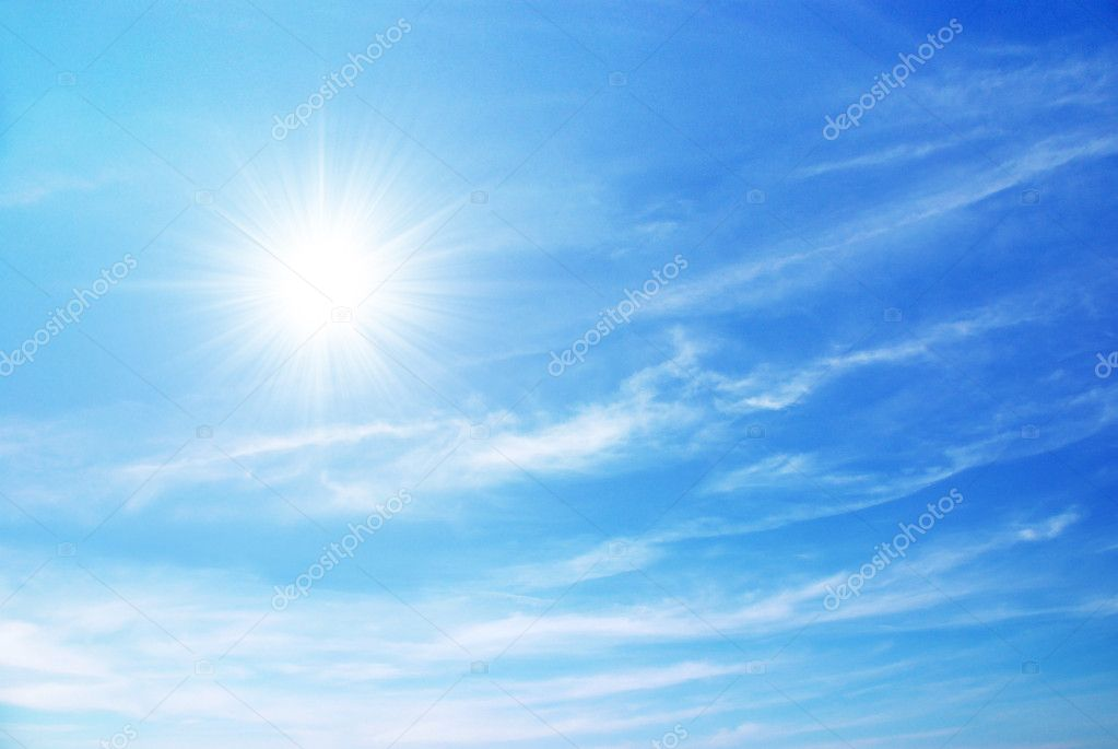 Bright blue sky with sun shining and some clouds  Stock Photo #5875268
