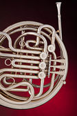 Silver French Horn Isolated on Red — 图库照片