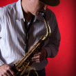 Saxophone Player on Red — Stock Photo