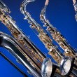 Four Saxophones on Blue — Stock Photo #5911003