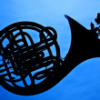 French Horn Silhouette On Blue — Stock Photo #5940297