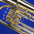 Tuba Euphonium Isolated on Blue - Stock Photo