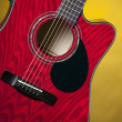 Red Acoustic Guitar on Yellow - Stock Photo