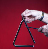 Triangle Played Isolated on Red — Stock Photo