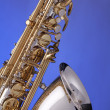 Saxophone Alto Isolated on Blue — Stock Photo #5974179