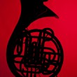 French Horn Silhouette on red — Stock Photo #5974287