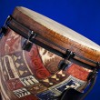 African Latin Djembe Drum on Blue - Stock Photo