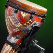 African Latin Djembe Drum on Green - Stock Photo