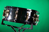 Chrome Gold Snare Drum on Green — Stock Photo