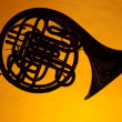 French Horn Silhouette Isolated on Yellow — Stock Photo #6021449