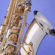 Saxophone Alto Isolated On Blue — Stock Photo #6079543
