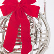 Stock Photo: Christmas Ribbon French Horn Isolated