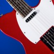 Red Electric Guitar On Blue — Stock Photo