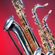 Three Saxophones Isolated on Red — Stock Photo #6256420