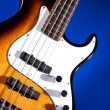Bass Guitar Isolated on Blue — Stock Photo