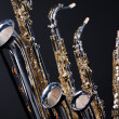 Saxophones Set of Four Isolated on black — Stock Photo