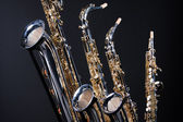 Saxophones Set of Four Isolated on black — Стоковое фото
