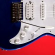 Blue Guitar Isolated On Red — Stock Photo