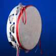 Tambourine Isolated on Blue — Stock Photo