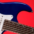 Blue Electric Guitar Isolated on Red — Stock Photo