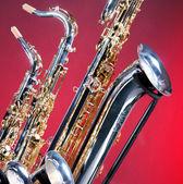 Three Saxophones on Red — Stock Photo