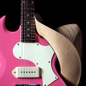 Pink Guitar with Western Hat — Stock Photo