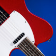 Metallic Red Guitar on Blue — Stock Photo