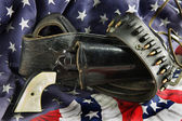 Western Gun in Holster on Flag — Stock Photo