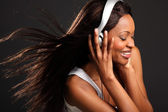 Beautiful woman listening to music — Stock Photo