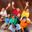 Six school children on classroom floor — Stock Photo #5867064