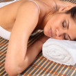 Woman lying face down in spa — ストック写真