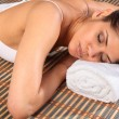 Woman lying face down in spa — Stock fotografie