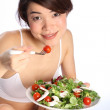 Beautiful girl eating healthy salad — Stock Photo #5869490