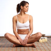 Woman fit body sitting cross legged — Stock Photo