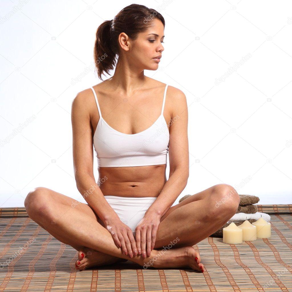 Woman Fit Body Sitting Cross Legged Stock Photo