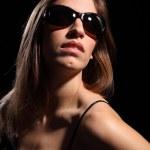 Beautiful woman wearing dark sunglasses — Stock Photo